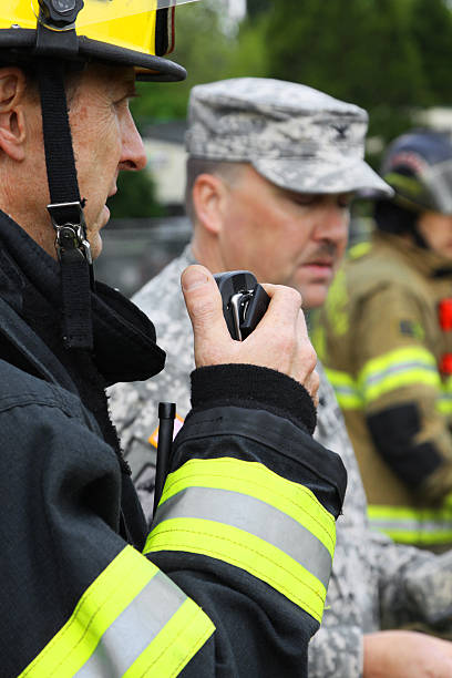 disaster drill communications - emergency response stock pictures, royalty-free photos & images