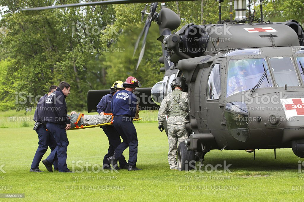 Disaster Drill Helicopter Right Loading Backboard Injured stock photo