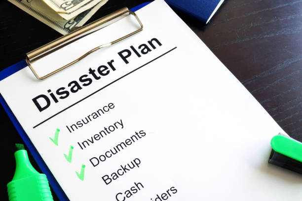 Disaster Plan on a table. stock photo