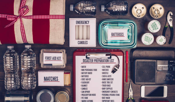 Disaster preparation kit flat lay. Items needed for disaster preparedness stock photo
