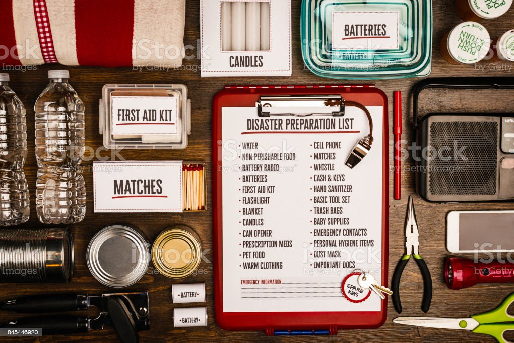 Disaster preparation kit flat lay. Items needed for disaster preparedness royalty-free stock photo
