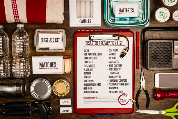 Disaster preparation kit flat lay. Items needed for disaster preparedness Disaster preparation kit flat lay. Items needed for disaster preparedness accidents and disasters stock pictures, royalty-free photos & images