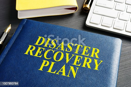 istock Disaster Recovery Plan on an office table. 1007950764