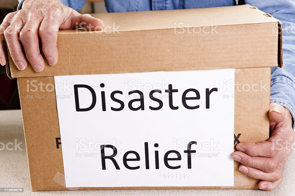 Disaster relief package being delivered man volunteer. Aid. Shipping. stock photo