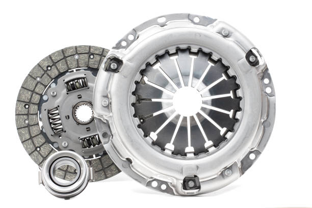 Disc and clutch basket with release bearing A new set of replacement automotive clutch on a white background. Disc and clutch basket with release bearing coupling device stock pictures, royalty-free photos & images