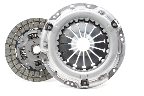 Disc and clutch basket with release bearing A new set of replacement automotive clutch on a white background. Disc and clutch basket with release bearingA new set of replacement automotive clutch on a white background. Disc and clutch basket with release bearing vehicle clutch stock pictures, royalty-free photos & images