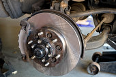 tire has been removed and new disc brake rotor and pads installed by mechanic