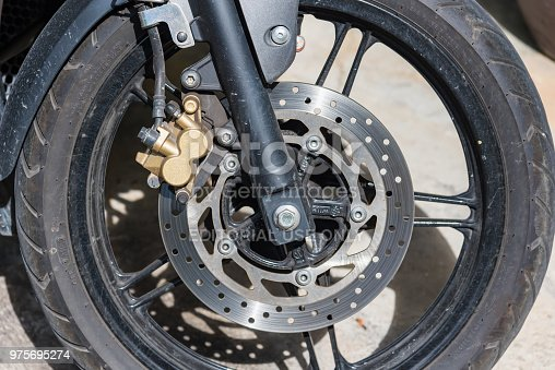 istock Disc brakes on the front wheels of Bigbike motorcycle brand Yamaha Steed 500CC at Damnoen Saduak Floating Market in Ratchaburi,Thailand 975695274