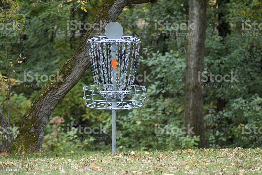 Disc Golf Basket and Woods royalty-free stock photo