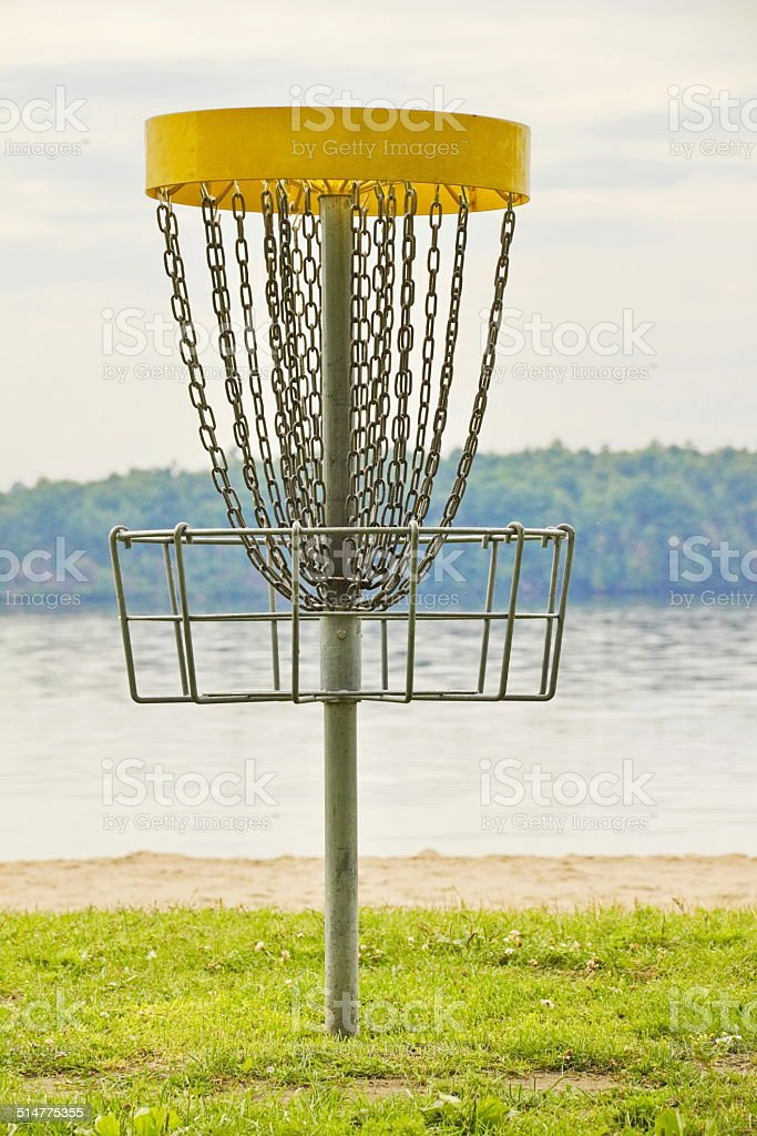 Disc Golf Basket by the Water stock photo