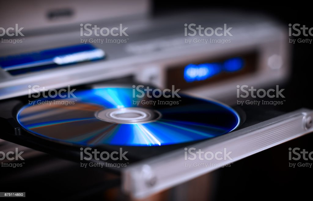 DVD disc inserting to player royalty-free stock photo