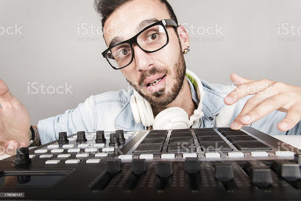 Disc Jockey with mixer royalty-free stock photo