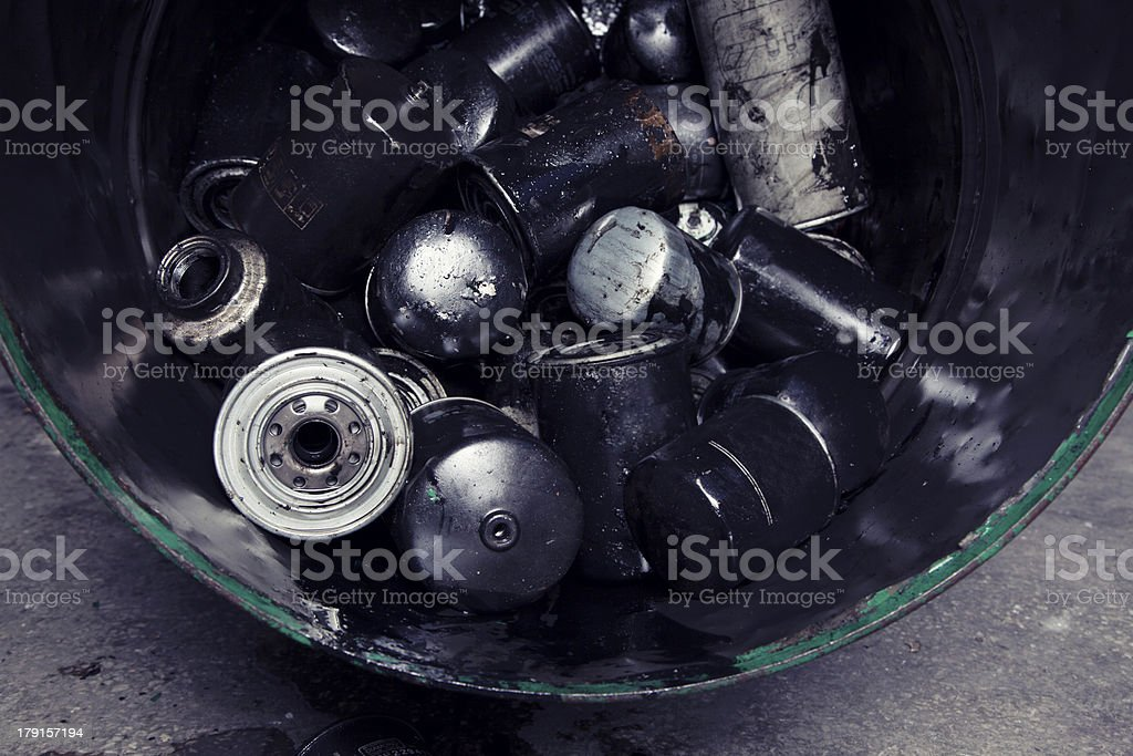 Discarded Batteries in barrel royalty-free stock photo