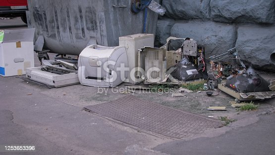 istock Discarded computer equipment in a landfill. Printers monitors and computers. Environmental pollution. Stock photo background 1253653396