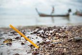 One plastic drinking straw has washed up from the sea.  Seemingly harmless, it represents the massive environmental issue that is Global Plastic Pollution.  Plastic pollution is said to be one of the largest threats to our ecosystems.  Over 8 million tonnes is dumped in the Ocean every year.  Discarded, abandoned or obsolete items which become dangerous garbage, is responsible for the deaths of huge amounts of wildlife every year, through entanglement and consumption.  The location here is Ko Lanta, Krabi, Thailand.