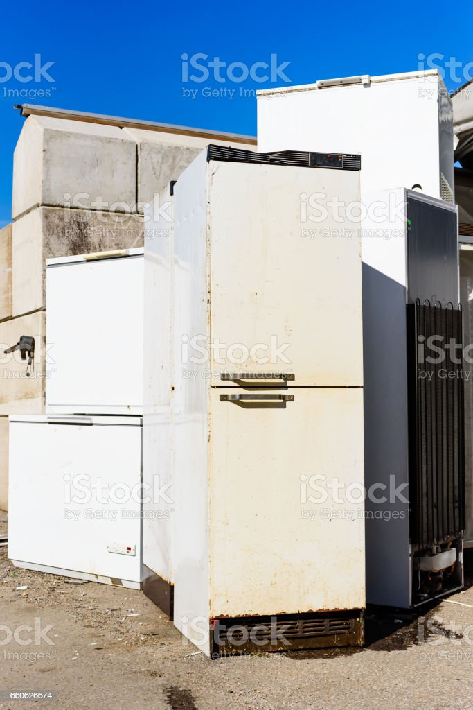 Discarded fridge and freezers stock photo