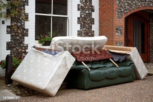 A pile of discarded furniture in a street.