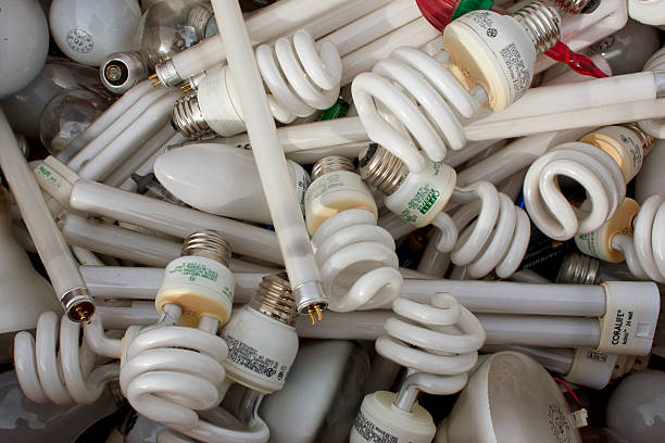 discarded light bulbs fill box at recycling event - fluorescent light stock pictures, royalty-free photos & images