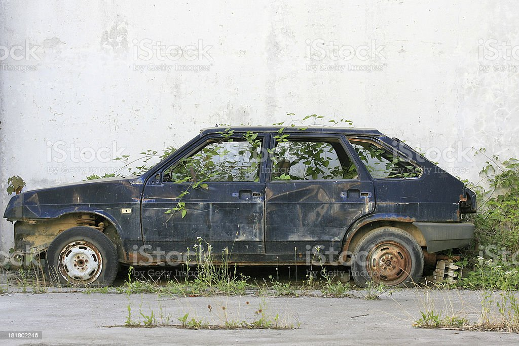 discarded old car stock photo