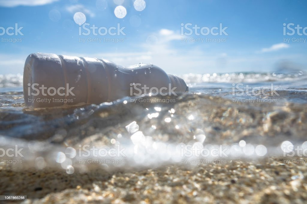 discarded Plastic bottle floating on the sea surface. stock photo