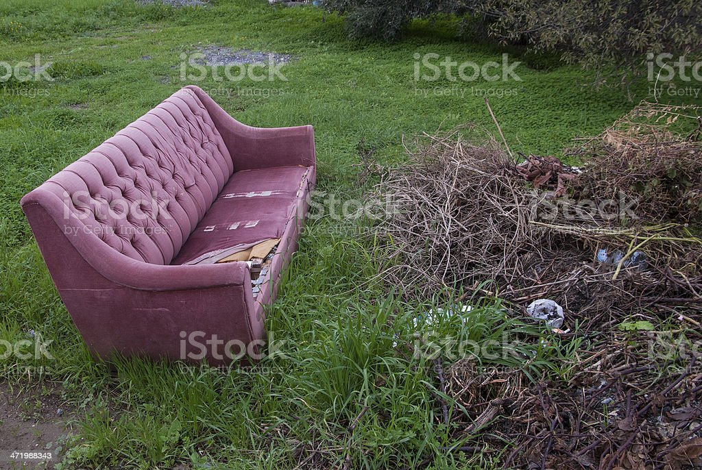 discarded sofa stock photo
