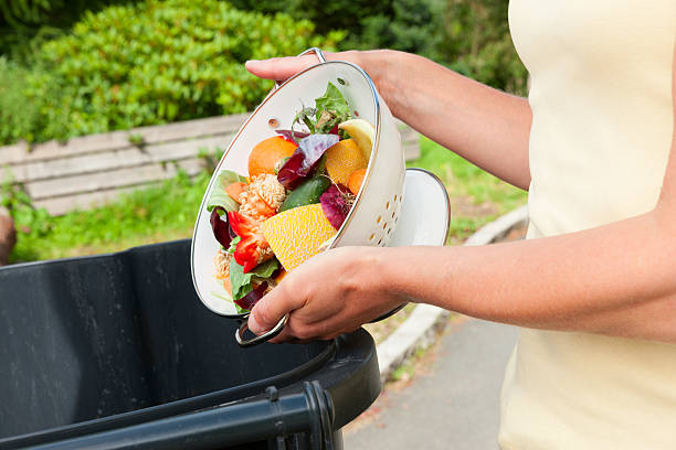 Discarding fruit and vegtable waste stock photo