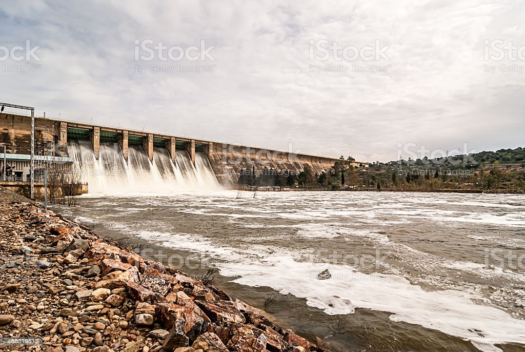 discharge of water in marsh Orellana Spain stock photo
