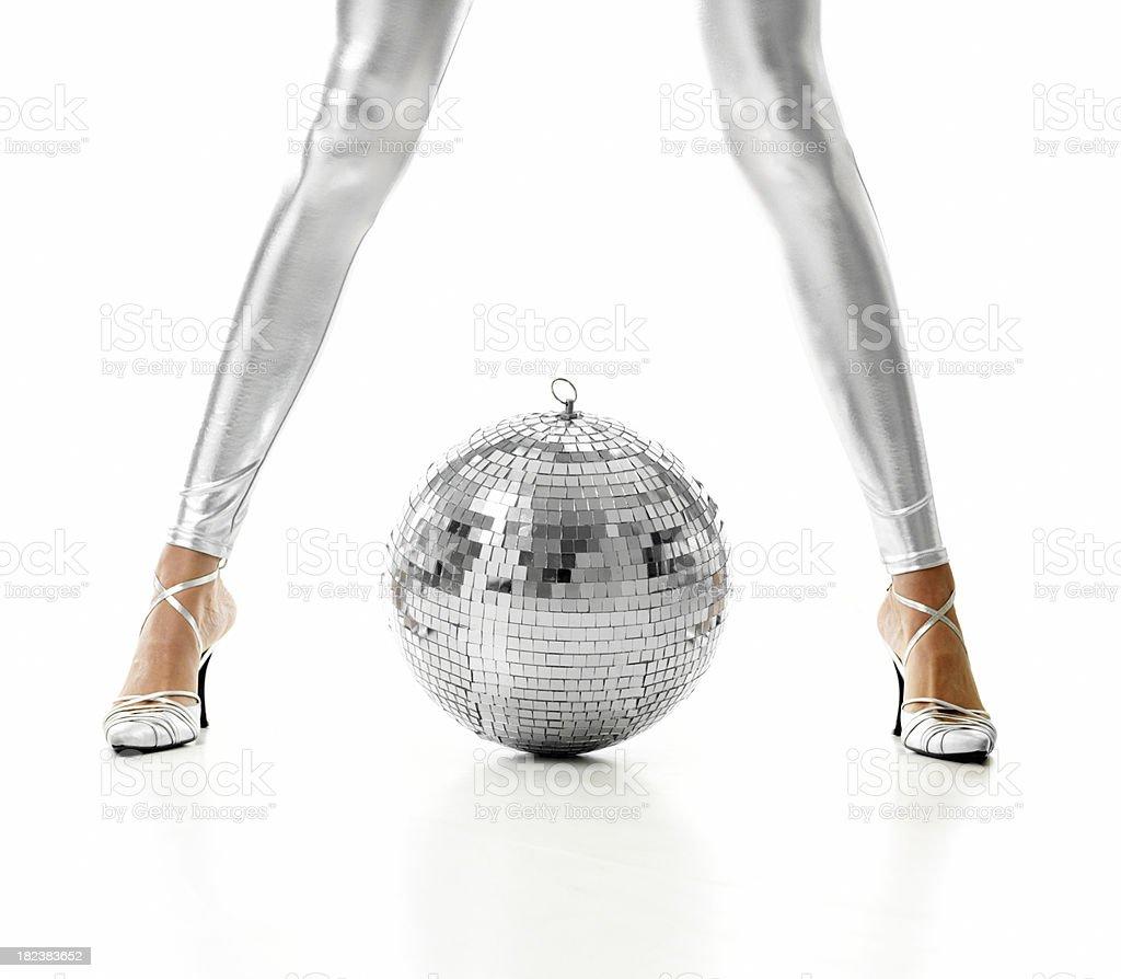 Disco ball and legs stock photo