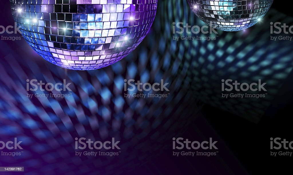 Disco ball giving off a purple and blue light royalty-free stock photo