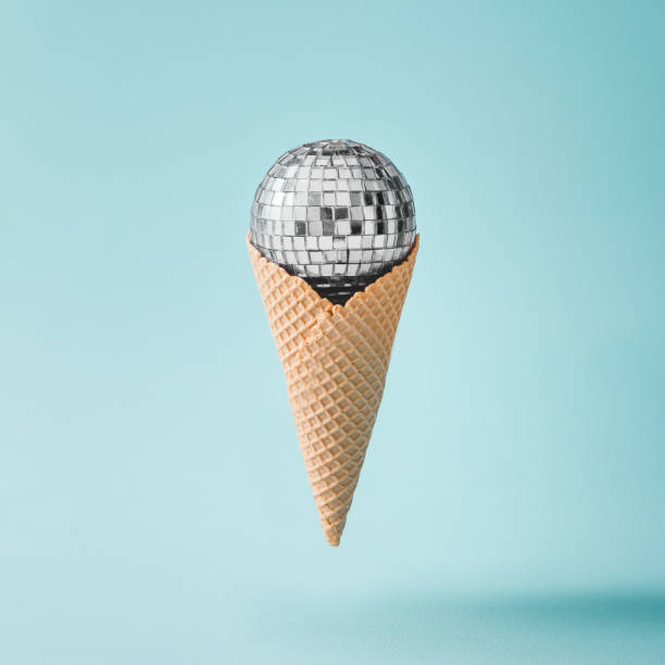 Disco ball ice cream on bright blue background. Minimal party concept. stock photo