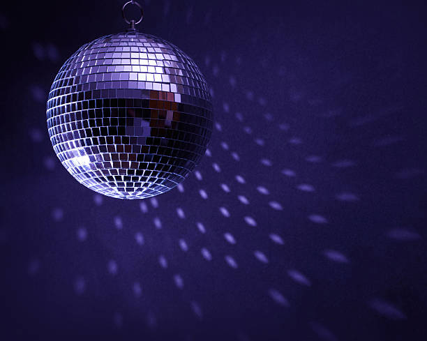 disco ball in a dark room creating spots on the wall - disco ball stock pictures, royalty-free photos & images