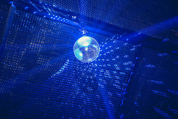 disco ball in blue lights - disco lights stock pictures, royalty-free photos & images