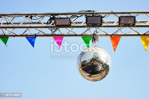 Disco ball with bright rays on day