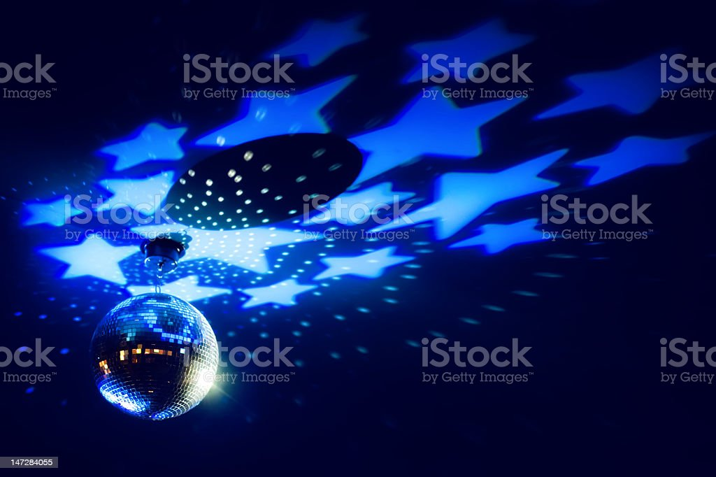 Disco ball with a bright blue stars royalty-free stock photo