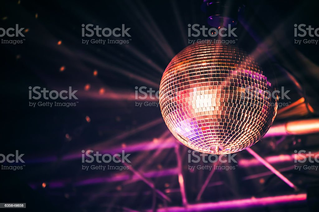 Disco ball with bright rays, night party stock photo