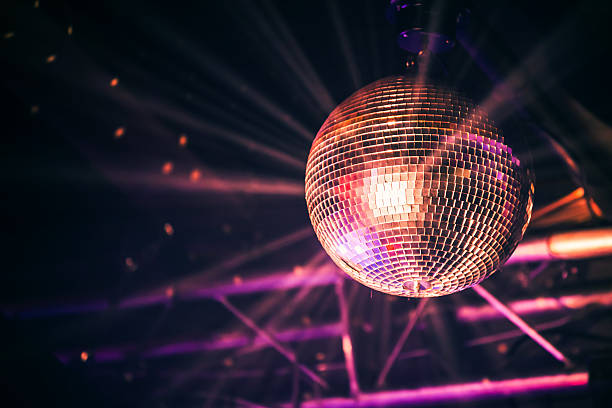 disco ball with bright rays, night party - rosa lampe stock-fotos und bilder