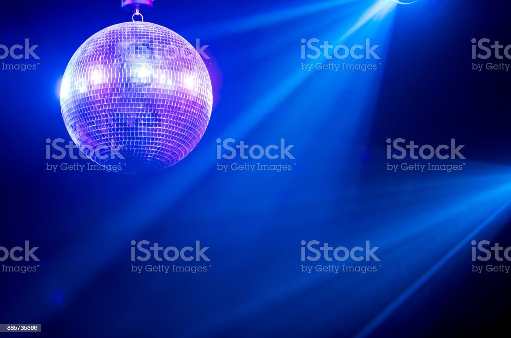 Disco ball with bright rays stock photo