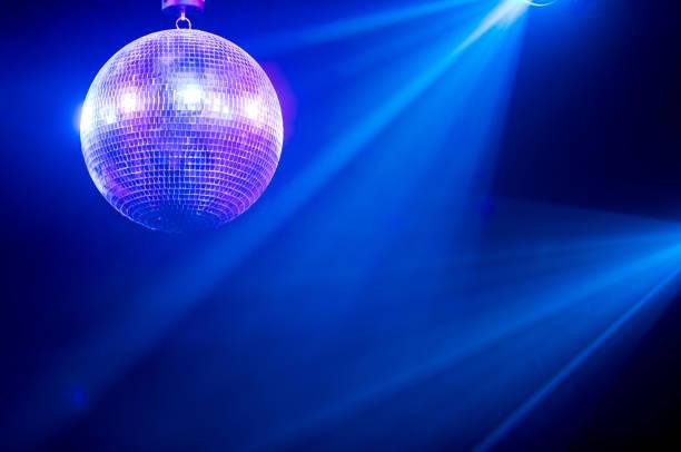 Disco ball with bright rays stock photo