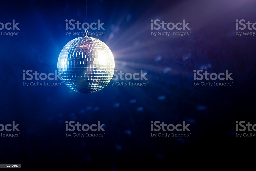 Disco ball with light rays stock photo