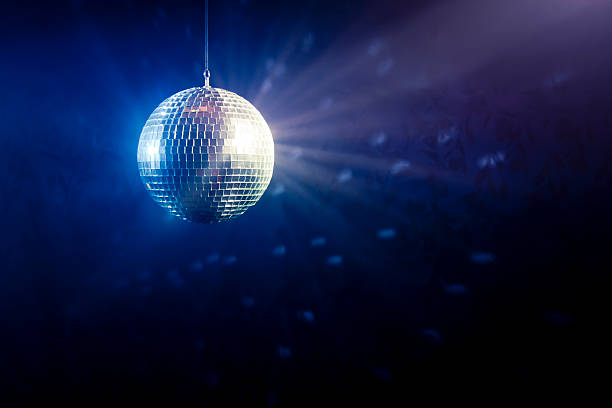 Disco ball with light rays Photo of a shinny disco ball disco ball stock pictures, royalty-free photos & images