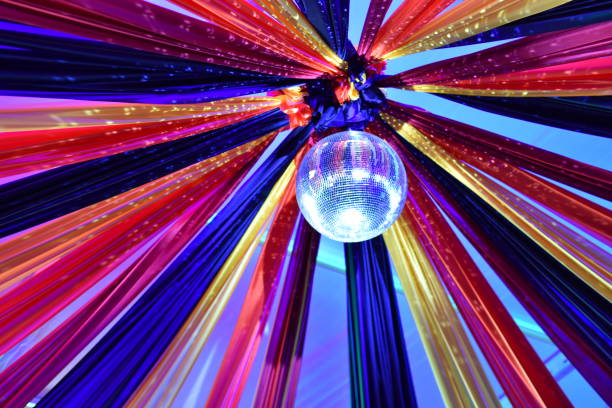 disco ball with multi-colored fabric - steven harrie stock photos and pictures