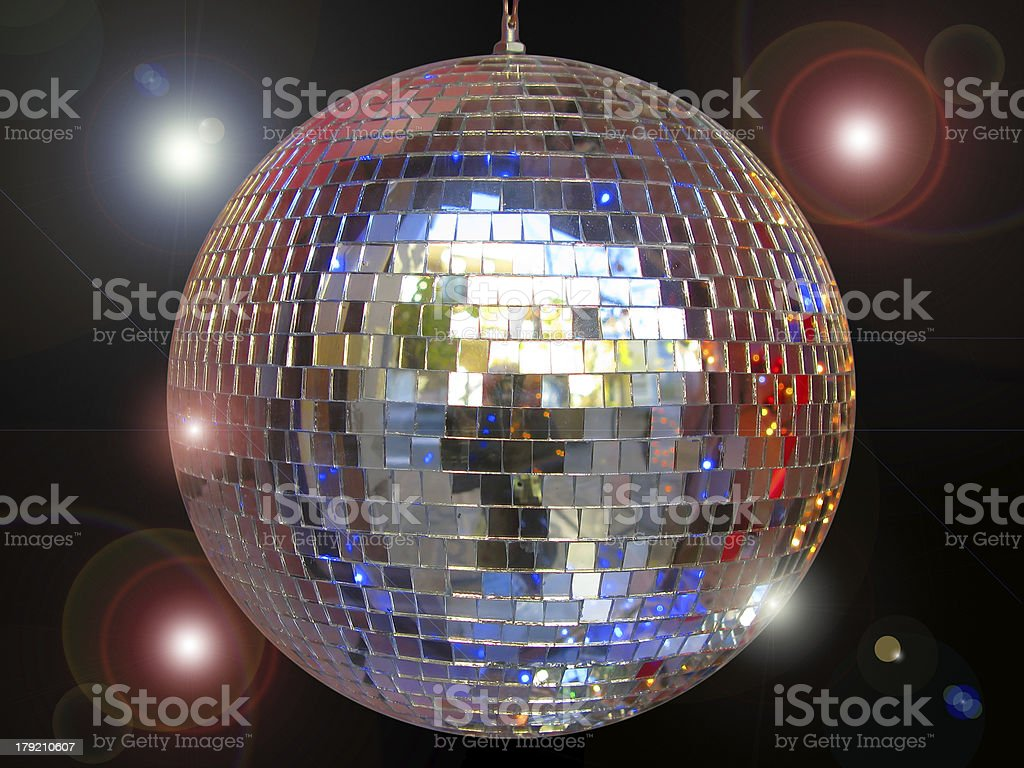 Disco ball with sparkles isolated in black royalty-free stock photo