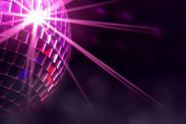 disco ball with violet star burst and fog in club - disco ball stock pictures, royalty-free photos & images