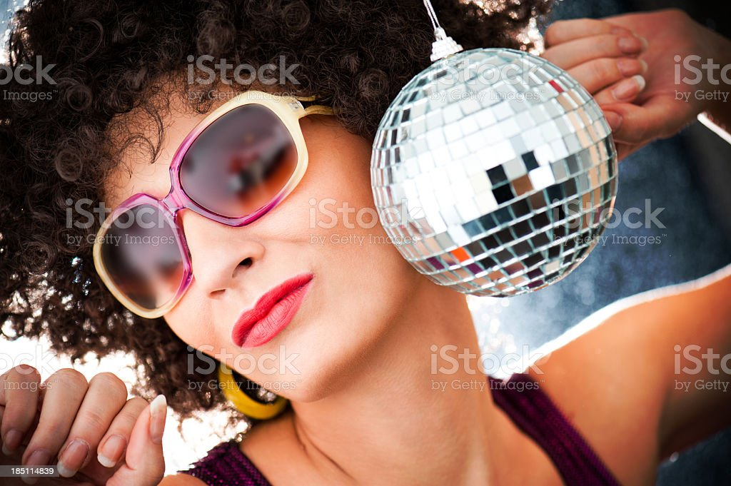 Disco ball with woman in sunglasses stock photo