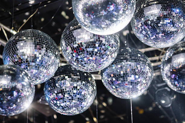 disco balls on the ceiling many disco ball on a gray ceiling disco ball stock pictures, royalty-free photos & images