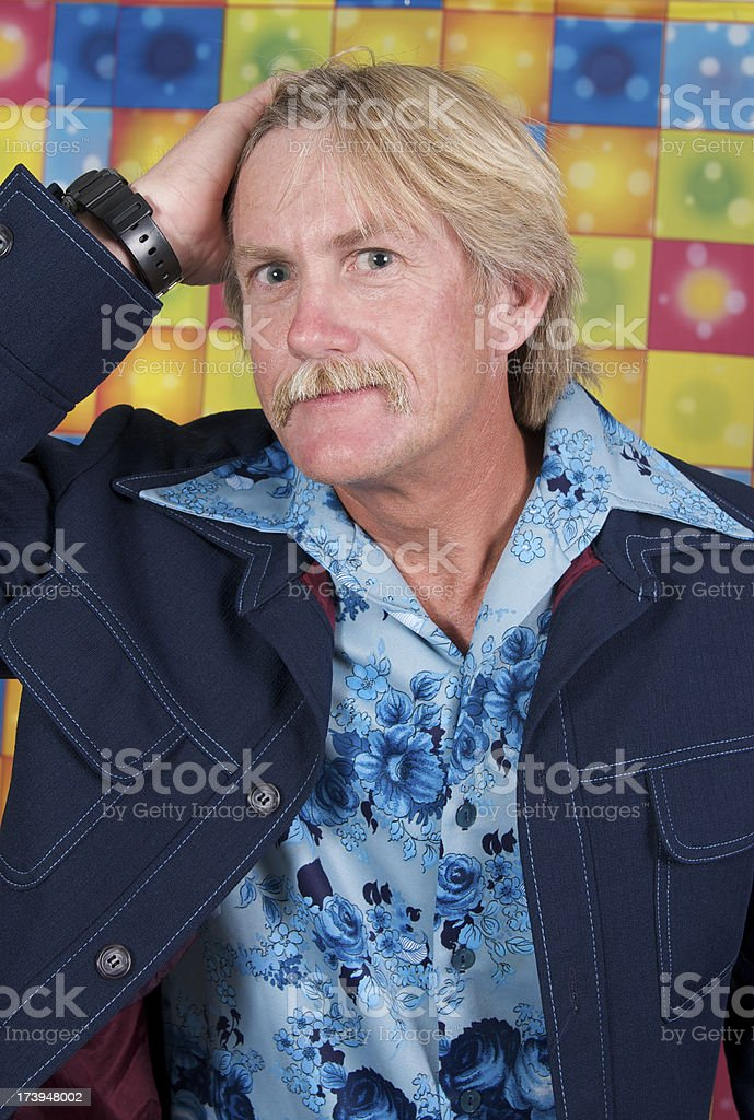 Disco Man Fixing His Hair royalty-free stock photo