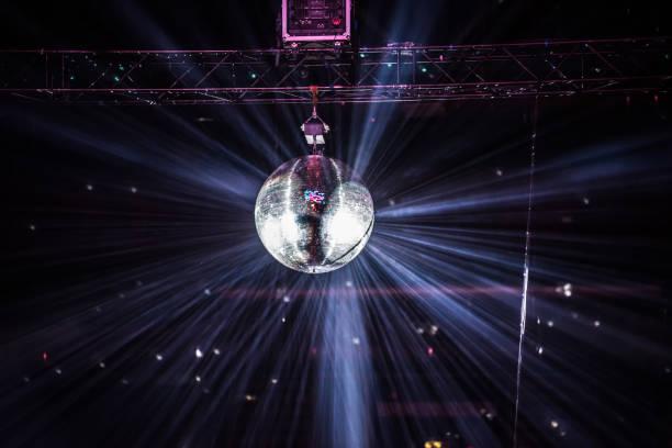 Disco mirror ball hanging at a retro party stock photo