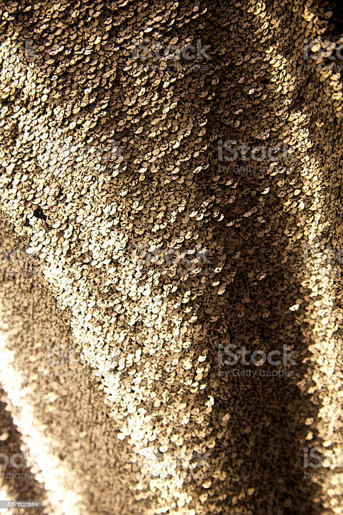 Disco sequins gold textile fabric pattern glitter shimmering glamour background stock photo