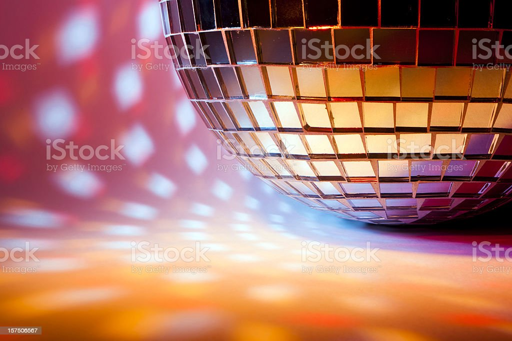 Disco sphere with colored spot lights stock photo
