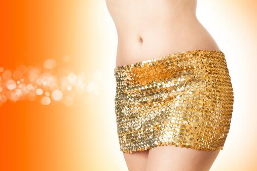 Disco woman in golden skirt